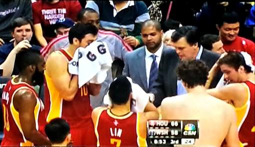 Omer Asik shirtless in Houston Rockets huddle