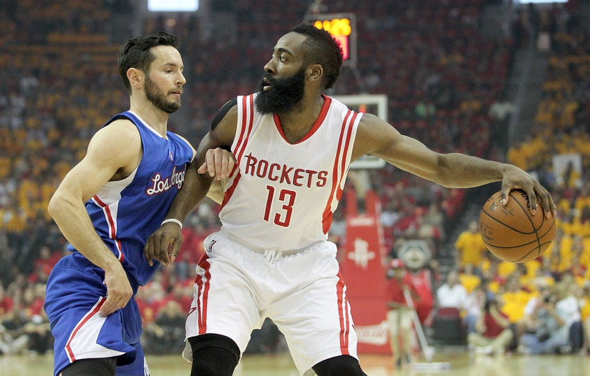 May 12, 2015; Houston, TX, USA; Houston Rockets guard James Harden (13) dribbles against Los Angeles Clippers guard J.J. Redick (4) in the first quarter in game five of the second round of the NBA Playoffs. at Toyota Center. Mandatory Credit: Thomas B. Shea-USA TODAY Sports