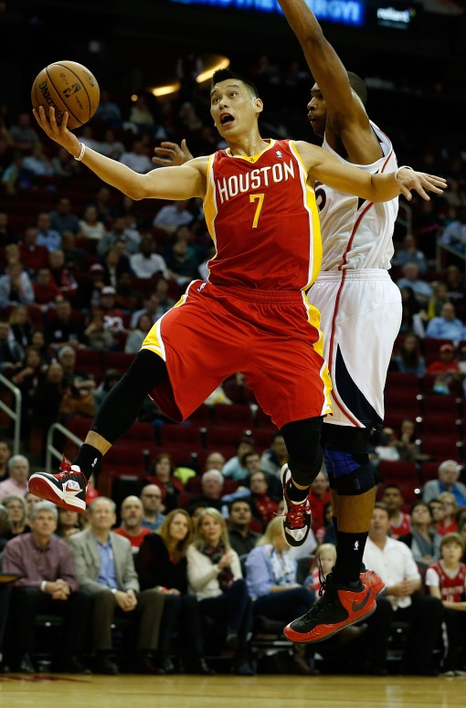 Jeremy Lin lays the ball up against Al Horford last night (Atlanta Hawks v Houston Rockets)