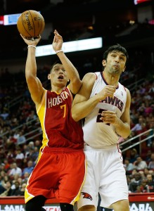 Jeremy Lin hits Zaza Pachulia on his way to the hoop against the Atlanta Hawks v Houston Rockets