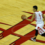 Jeremy Lin dribbles upcourt at the Toyota Center