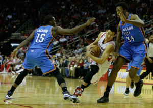 Jeremy Lin protects the ball as he drives against Hasheem Thabeet and the OKC Thunder