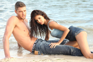 shirtless Chandler Parsons models in the water