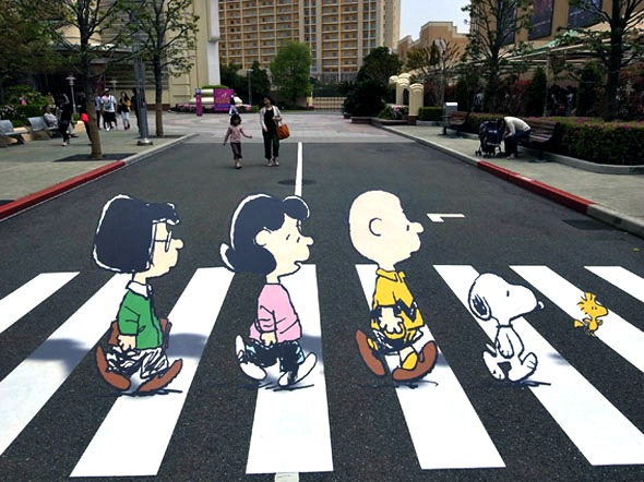 Charlie Brown and Snoopy cross Abbey Road