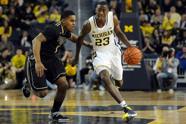 Caris Levert dribbles for Michigan Basketball