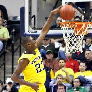 Michigan's Caris Lavert throws down left-handed slam against Illinois