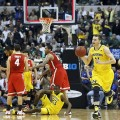 Nik Stauskas heads up court after the ball slipped out of Aaron Craft's hands