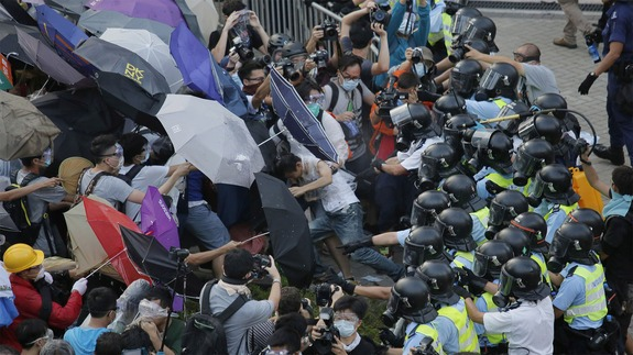 Demonstraters Stand Against Hong Kong Riot Police Onslaught
