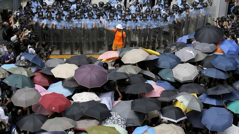 Standoff between Hong Kong police and protesters with their shields
