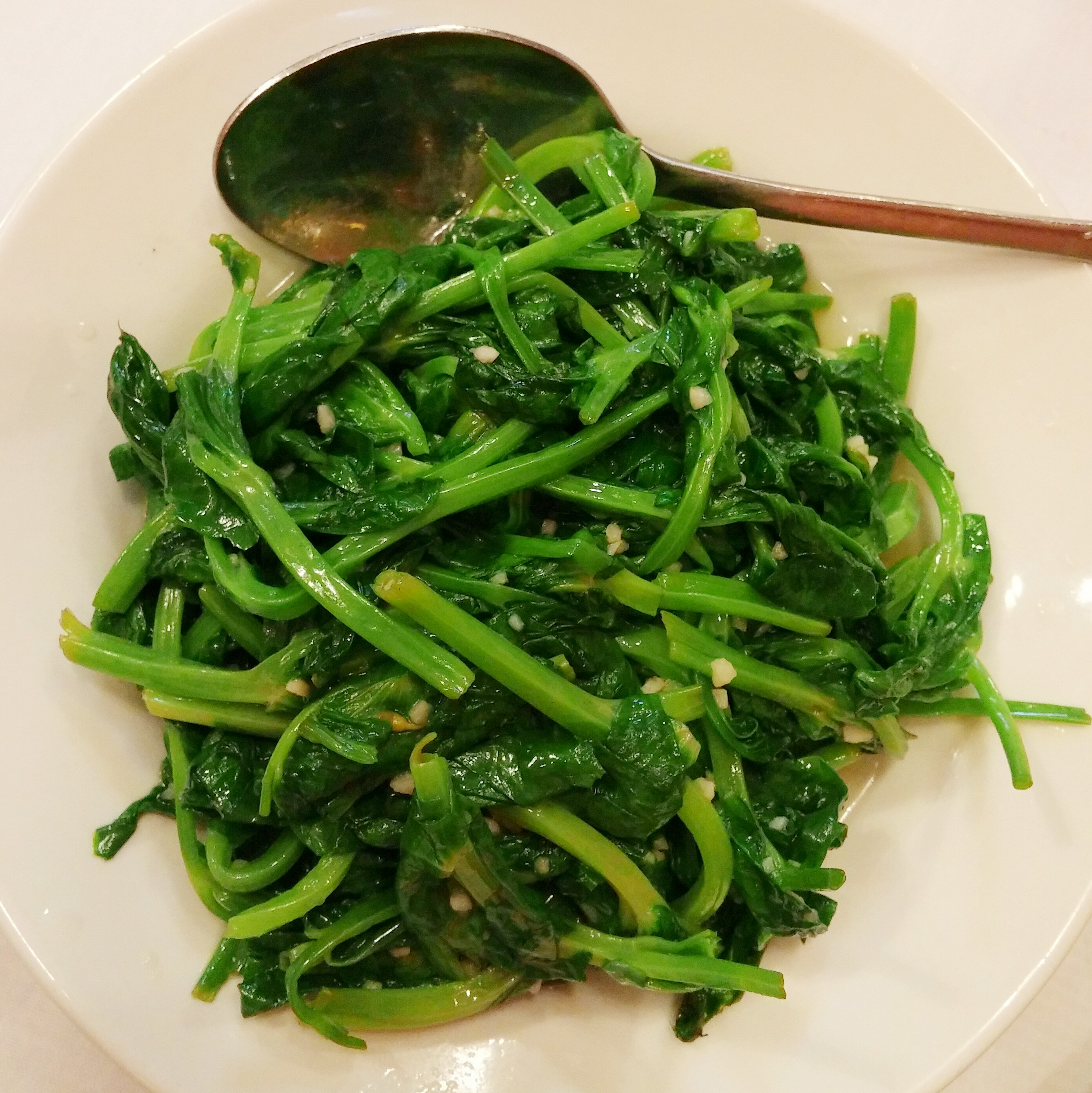 That expensive vegetable dish you had at dim sum is called dao mew (garlic pea shoots)