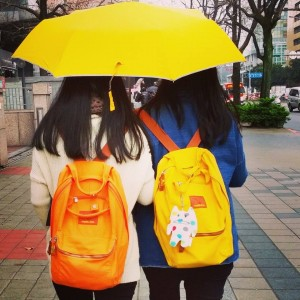 Colorful gals walking around