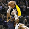 Kyrie Irving shoots over Kawhi Leonard of the San Antonio Spurs