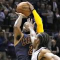 Kyrie Irving shoots over Kawhi Leonard of the San Antonio Spurs