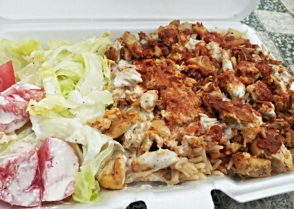 Are halal cart 'chicken over rice' plates healthy and how many total calories without rice and white sauce?